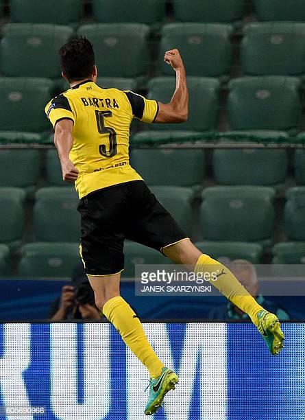 Dortmund's Spanish defender Marc Bartra celebrates scoring his team's third goal during the UEFA Champions League group F football match Legia Warsaw...