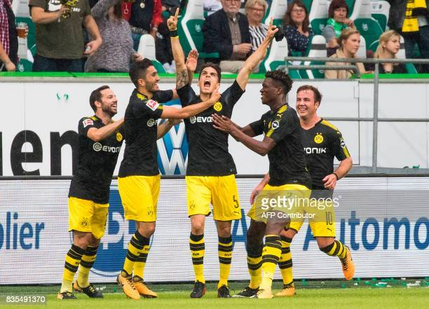 Dortmund´s Spanish defender Marc Bartra celebrates scoring his team's second goal with team mates during the German First division Bundesliga...