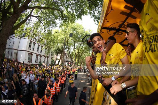 Dortmund's Spanish defender Marc Bartra celebrates with his teammates as they arrive at Borsigplatz during celebrations after winning the German Cup...