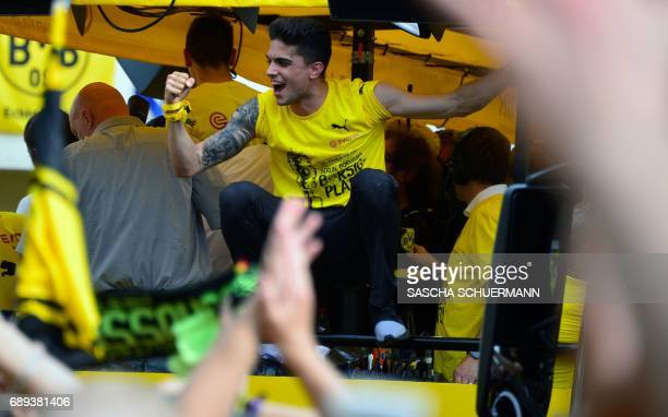 Dortmund's Spanish defender Marc Bartra gestures during celebrations after winning the German Cup final in Dortmund western Germany on May 28 2017 /...