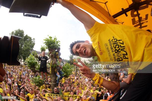 Dortmund's Spanish defender Marc Bartra poses as they arrive at Borsigplatz during celebrations after winning the German Cup final in Dortmund...