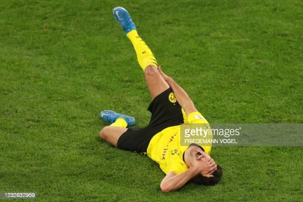 Dortmund's Spanish defender Mateu Morey reacts after sustaining an injurg during the German Cup semi-final football match BVB Borussia Dortmund v...