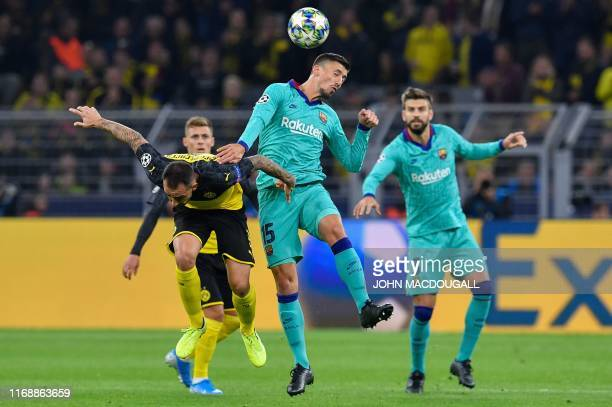 Dortmund's Spanish forward Paco Alcacer and Barcelona's French defender Clement Lenglet vie for the ball during the UEFA Champions League Group F...