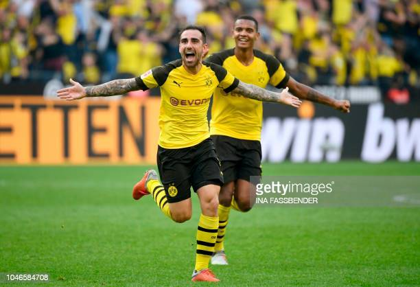 Dortmund's Spanish forward Paco Alcacer and Dortmund's French defender Abdou Diallo celebrate scoring the 4-3 against Augsburg during the German...