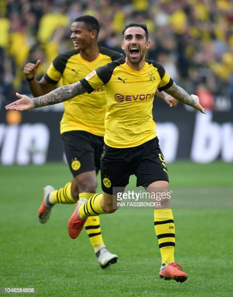 Dortmund's Spanish forward Paco Alcacer and Dortmund's French defender Abdou Diallo celebrate scoring the 43 against Augsburg during the German first...