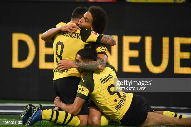 TOPSHOT Dortmund's Spanish forward Paco Alcacer celebrate after scoring the 32 goal with Dortmund's Belgian midfielder Axel Witsel and Dortmund's...