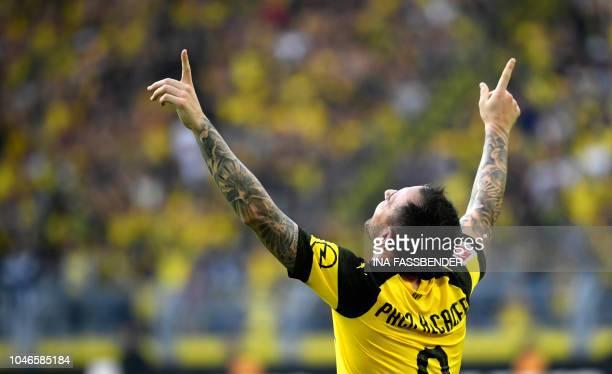 Dortmund's Spanish forward Paco Alcacer celebrates scoring the 43 against Augsburg during the German first division Bundesliga football match...