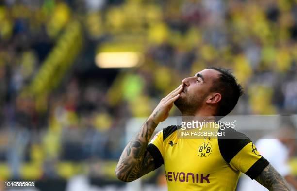 TOPSHOT Dortmund's Spanish forward Paco Alcacer celebrates scoring the 43 against Augsburg during the German first division Bundesliga football match...