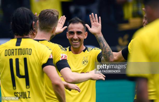 Dortmund's Spanish forward Paco Alcacer celebrates scoring with his teammates during the German first division Bundesliga football match BVB Borussia...