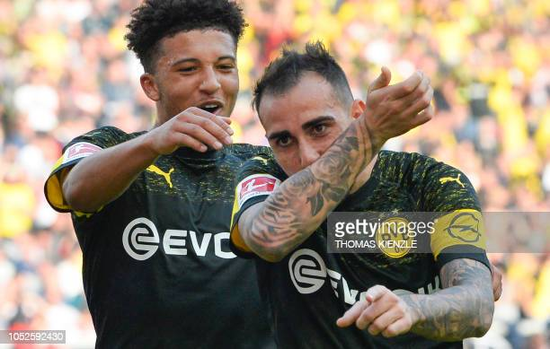 Dortmund's Spanish forward Paco Alcacer celebrates with teammate English midfielder Jadon Sancho after Alcacer scored the team's third goal during...
