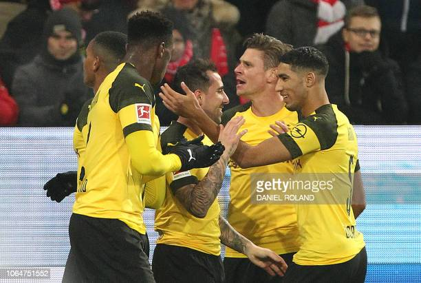 Dortmund's Spanish forward Paco Alcacer is congratulated by teammates after scoring the 10 during the German first division Bundesliga football match...