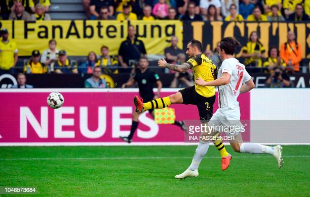 Dortmund's Spanish forward Paco Alcacer scores the 22 against Augsburg during the German first division Bundesliga football match Borussia Dortmund...