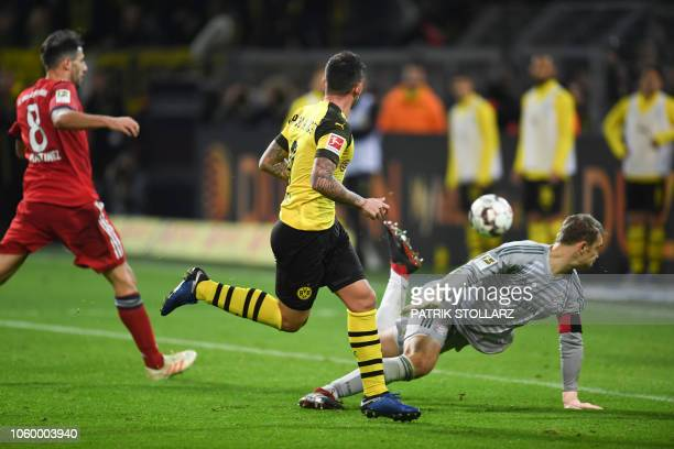 Dortmund's Spanish forward Paco Alcacer scores the 32 goal past Bayern Munich's German goalkeeper Manuel Neuer during the German first division...