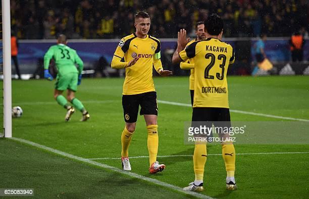 Dortmund's striker Marco Reus and Dortmund's Japanese midfielder Shinji Kagawa celebrate during the Champions League football match between Borussia...