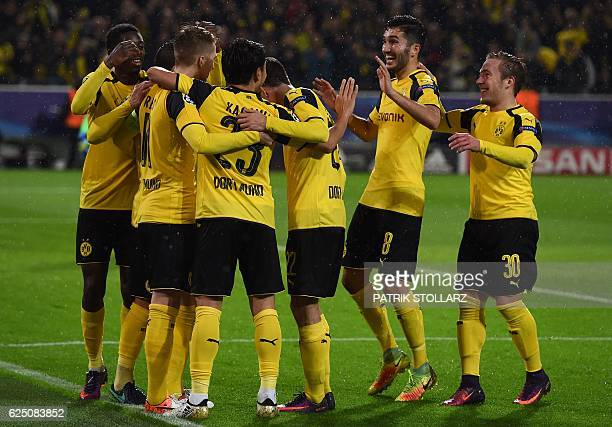 Dortmund's striker Marco Reus and his teammates celebrate during the Champions League football match between Borussia Dortmund and Legia Warszawa on...