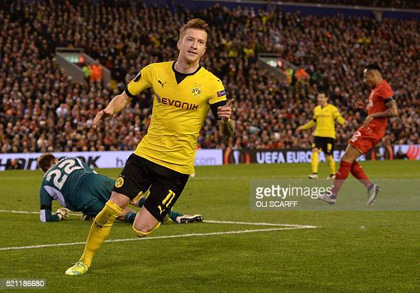 Dortmund's striker Marco Reus celebrates after scoring during the UEFA Europa league quarterfinal second leg football match between Liverpool and...