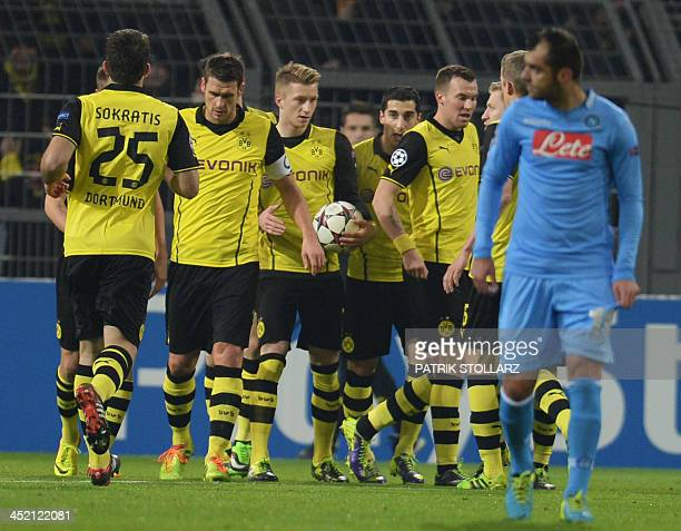 Dortmund's striker Marco Reus celebrates scoring with his teammates during the UEFA Champions League Group F football match Borussia Dortmund vs SSC...