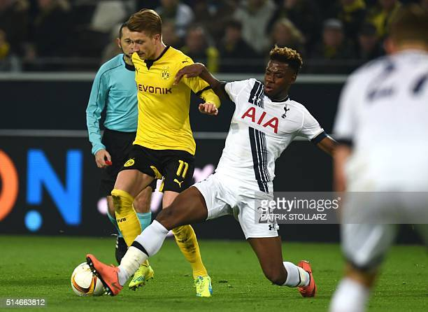 Dortmund's striker Marco Reus vies with Tottenham Hotspur's English midfielder Joshua Onomah during the UEFA Europa League Round of 16 firstleg...