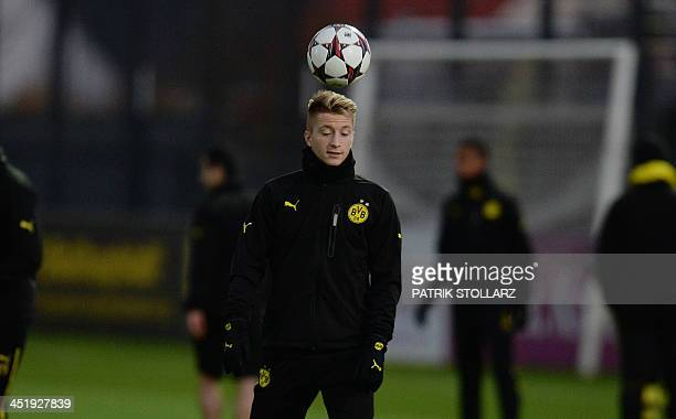 Dortmund's striker Marco Reus warms up during a training session at the training ground in DortmundBrackel western Germany on November 25 on the eve...
