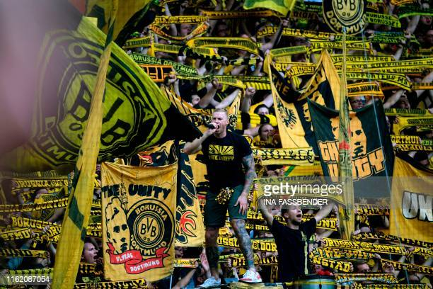 Dortmund's supporters celebrate the 51 victory over Augsburg after the German first division Bundesliga football match BVB Borussia Dortmund v...