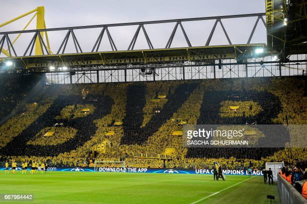 Dortmund's supporters choreograph their club's logo on the tribune during the UEFA Champions League 1st leg quarterfinal football match BVB Borussia...