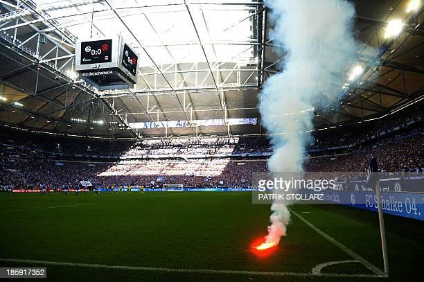 Dortmund´s supporters light fireworks prior to the German first division Bundesliga football match FC Schalke 04 vs Borussia Dortmund in the German...