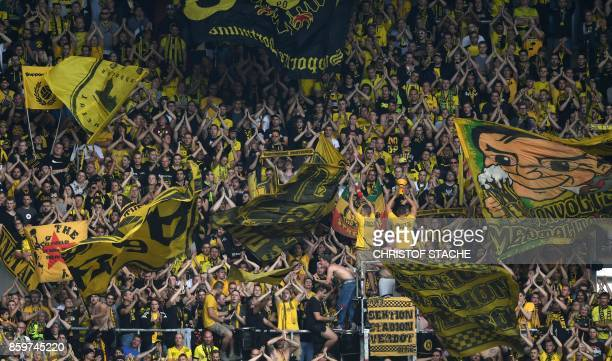 Dortmund's supporters wave giant flags during the German first division Bundesliga football match between FC Augsburg and Borussia Dortmund in...