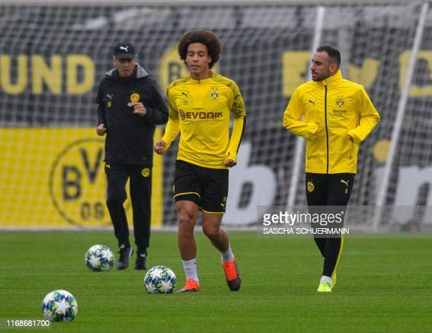 Dortmund's Swiss coach Lucien Favre oversees a training session of his players including Dortmund's Belgian midfielder Axel Witsel and Dortmund's...