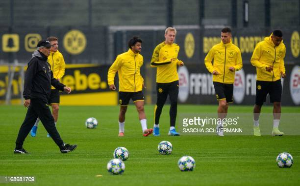 Dortmund's Swiss coach Lucien Favre oversees a training session of his players on the eve of the UEFA Champions League Group F football match between...