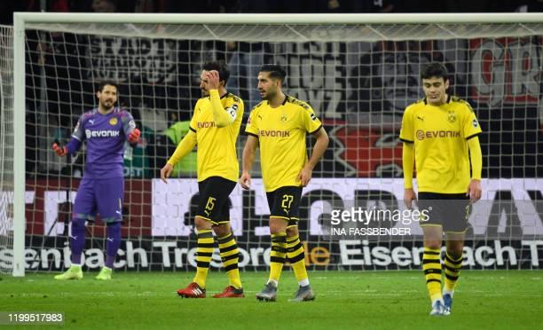 Dortmund's Swiss goalkeeper Roman Buerki Dortmund's German defender Mats Hummels Dortmund's German midfielder Emre Can and Dortmund's US midfielder...