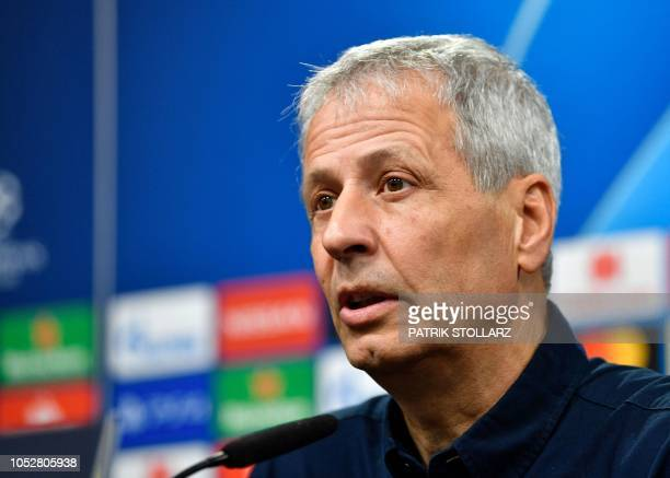 Dortmund's Swiss head coach Lucien Favre addresses a press conference on October 23 2018 in Dortmund on the eve of their UEFA Champions League...