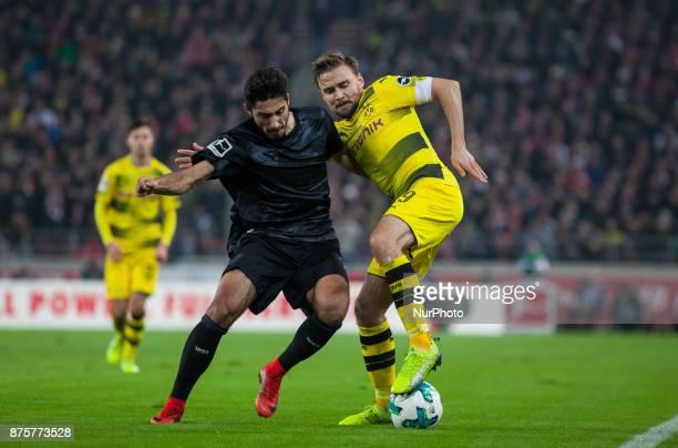 Dortmunds team captain Marcel Schmelzer in a duel with Stuttgarts Berkay Ozcan during the Bundesliga match between VfB Stuttgart and Borussia...