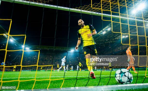 Dortmund´s Turkish defender Oemer Toprak picks the ball out of the net after Real Madrid's Welsh forward Gareth Bale scored the opening goal during...