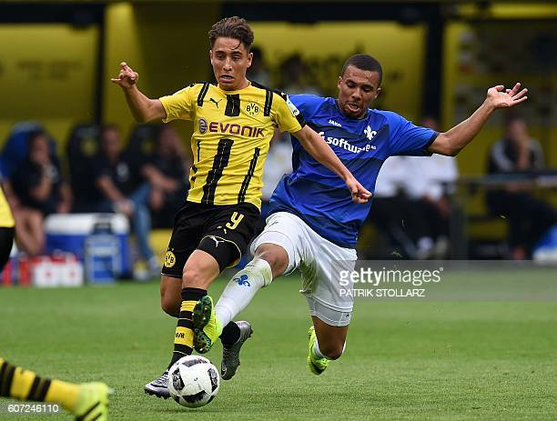 Dortmund's Turkish midfielder Emre Mor and Darmstadt's defender Leon Guwara vie for the ball during the German first division Bundesliga football...