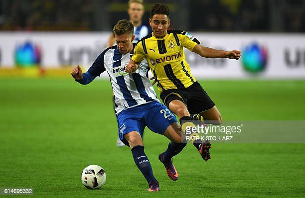 Dortmund's Turkish midfielder Emre Mor and Hertha's defender Mitchell Weiser vie for the ball during the German first division Bundesliga football...