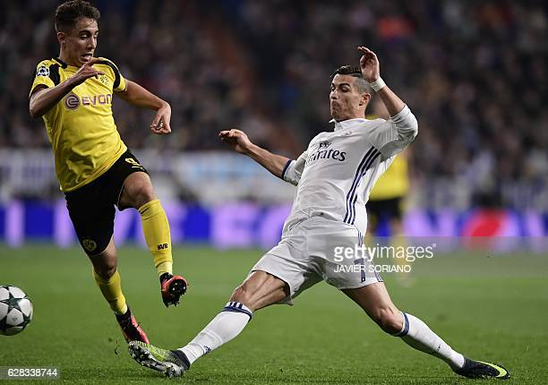 Dortmund's Turkish midfielder Emre Mor vies with Real Madrid's Portuguese forward Cristiano Ronaldo during the UEFA Champions League football match...