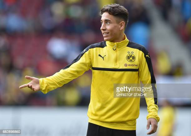 Dortmund's Turkish midfielder Emre Mor warms up prior to the German first division Bundesliga football match between FC Augsburg and Borussia...