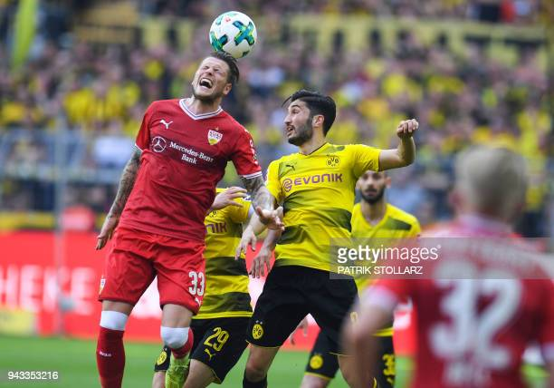 Dortmund's Turkish midfielder Nuri Sahin and Stuttgart's German forward Daniel Ginczek vie for the ball during the German first division Bundesliga...
