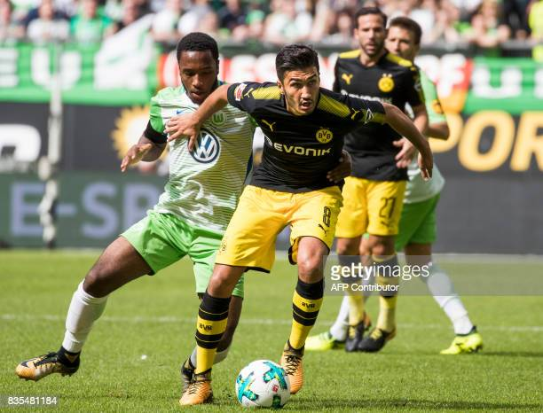 Dortmund's Turkish midfielder Nuri Sahin and Wolfsburg's English forward Kaylen Hinds vie for the ball during the German First division Bundesliga...
