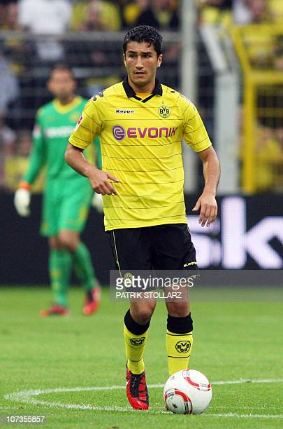 Dortmund's Turkish midfielder Nuri Sahin runs with the ball during the preseason football test match Borussia Dortmund vs Manchester City at the...