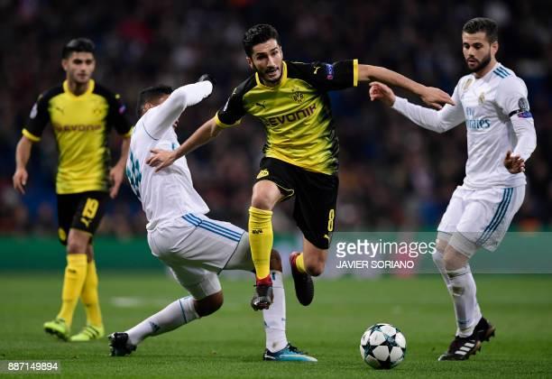 Dortmund's Turkish midfielder Nuri Sahin vies with Real Madrid's Spanish defender Nacho Fernandez and Real Madrid's Brazilian midfielder Casemiro...