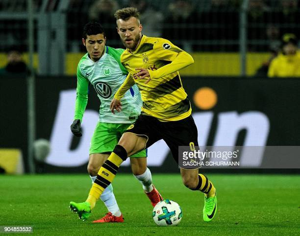 Dortmund's Ukrainian forward Andriy Yarmolenko and Wolfsburg's Brazilian defender William vie for the ball during the German first division...