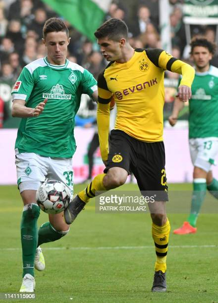 Dortmund's US midfielder Christian Pulisic and Bremen's Austrian defenfer Marco Friedl vie for the ball during the German first division Bundesliga...