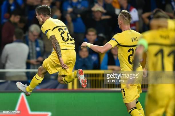 Dortmund's US midfielder Christian Pulisic celebrates after scoring during the UEFA Champions League Group C football match Club Brugge vs Borussia...
