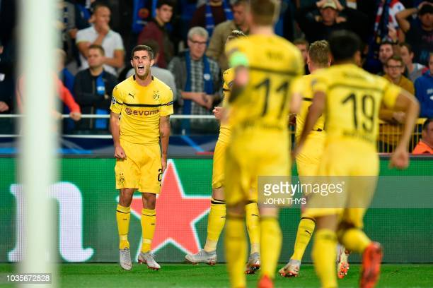 Dortmund's US midfielder Christian Pulisic celebrates after scoring during the UEFA Champions League Group C football match Club Brugge vs Borussia...