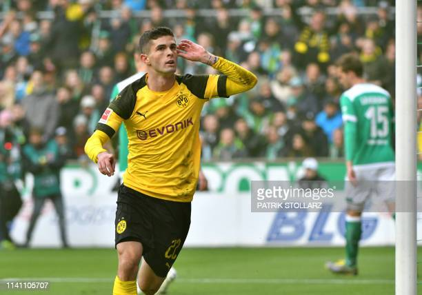 Dortmund's US midfielder Christian Pulisic celebrates scoring the opening goal during the German first division Bundesliga football match Werder...