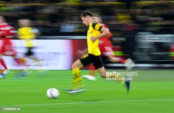 Dortmund's US midfielder Christian Pulisic controls the ball during the German first division Bundesliga football match BVB Borussia Dortmund v FC...