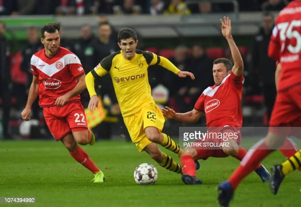 Dortmund's US midfielder Christian Pulisic , Fortuna Duesseldorf's Austrian midfielder Kevin Stoeger and Fortuna Duesseldorf's German midfielder...