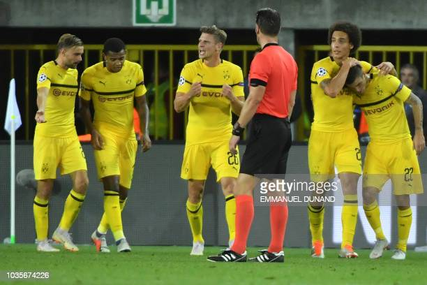 Dortmund's US midfielder Christian Pulisic is congratulated by teammates after scoring during the UEFA Champions League Group C football match Club...
