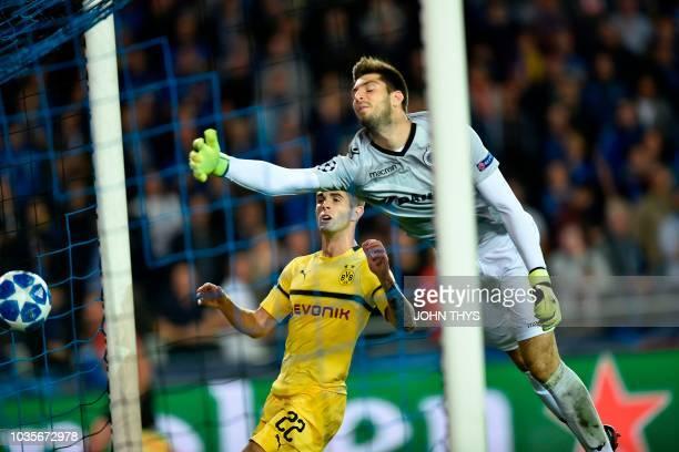 Dortmund's US midfielder Christian Pulisic scores during the UEFA Champions League Group C football match Club Brugge vs Borussia Dortmund at the Jan...